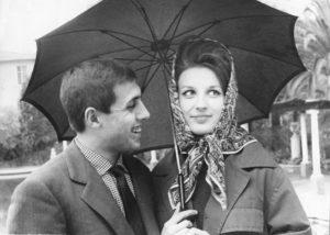 Italian singers and actors Adriano Celentano and Mina (Mina Anna Maria Mazzini) under the umbrella during the 11th Sanremo Music Festival. Sanremo, 1961
